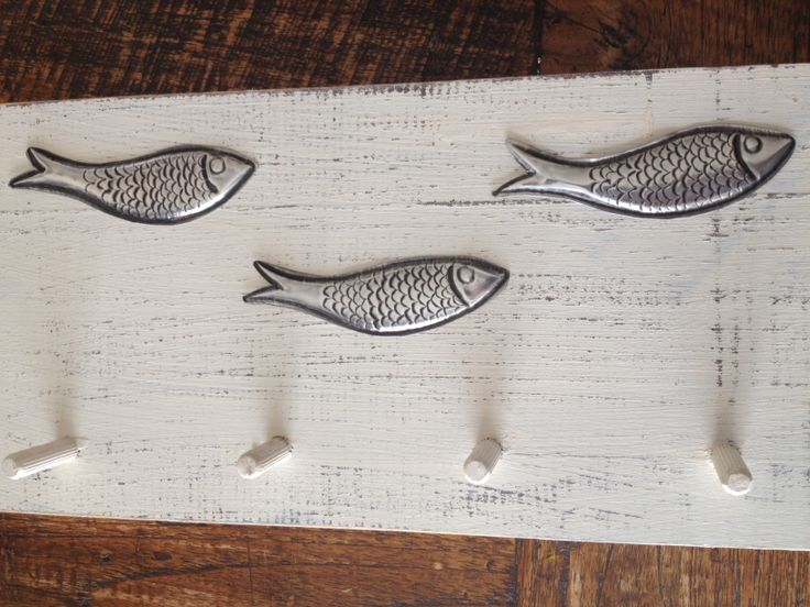 Wall hanger with embossed pewter fish  www.thepewterroom.co.za