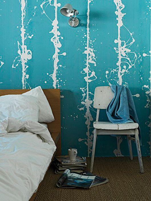 Paint splatter effect or wallpaper? It would be pretty neat to try and recreate with a paint brush and glass of wine in hand!