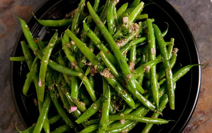 This French green bean salad recipe is tossed in a tangy Dijon mustard dressing and takes less than 30 minutes to prepare.