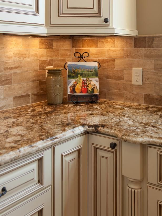 a gorgeous travertine backsplash transitions perfectly into the stunning talisman granite countertop providing just the right amount of visual interest