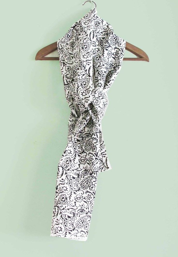 """Block-printed pure silk long scarf with black paisley print on white. Can be worn with a shirt or a jacket. Size: 23""""x78"""""""