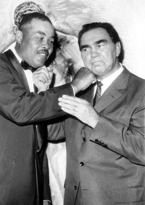 Max Schmeling and Joe Louis pose for photo during fourth anniversary of the U.S. 'People to People' program. Hotel Astor, NY, October 19, 1960.