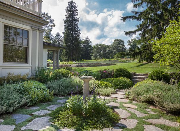 Seamlessly blending architecture with landscape. Farmhouse Landscape by Devore Associates