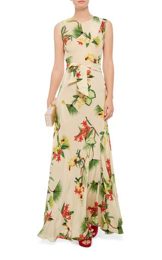 Crafted in floral printed silk, this **Isolda** maxi dress features an elegant figure-hugging silhouette for warm weather chic.