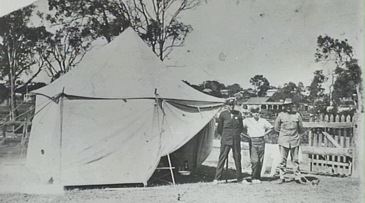 Ambulance tents were erected every Christmas and during school holidays in camping grounds. The two men at left in the photograph were probably ambulance officers or bearers, while the figure at right was probably a member of Redcliffe's local police force.