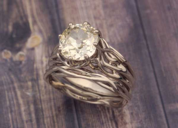 Embracing Tree Branch Engagement Ring in Natural White Gold.