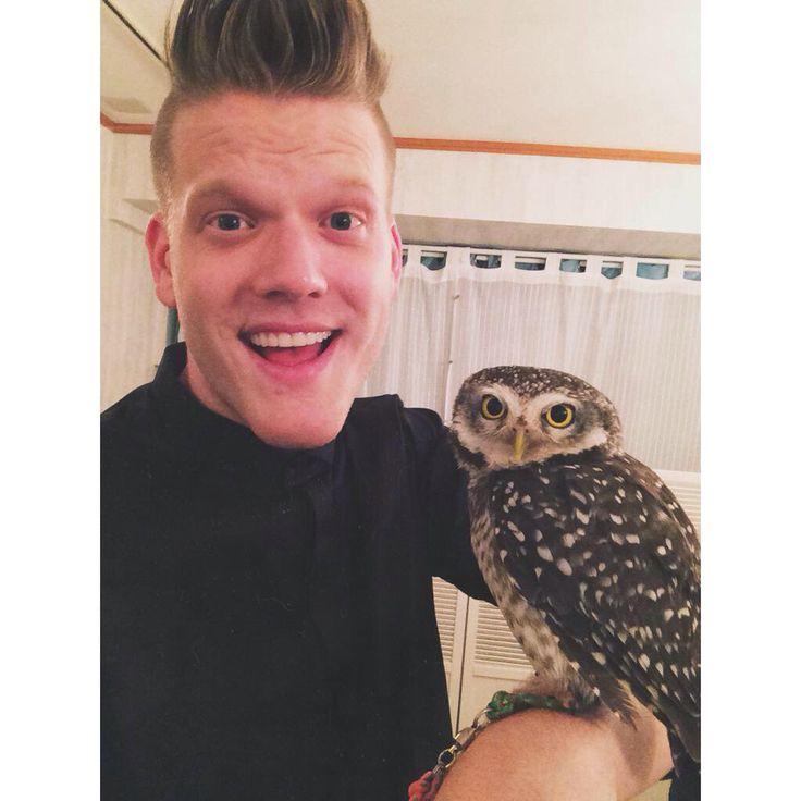 Scott holding an owl