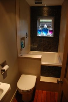 This micro bathroom has a bath and toilet in just 1.2m x 3m. I might add a half curtain behind the toilet.   Tiny Homes