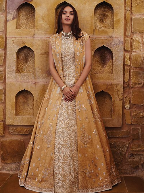 Long jacket anarkalis are here to stay and we love this dessert sand gold outfit by Anita Dongre. #Frugal2Fab