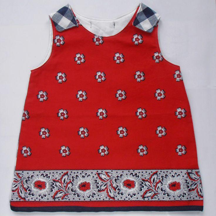 Dress MIES aap-noot-Mies! Folklore met dit rode-zakdoeken jurkje! Een bijpassende geblokt stofje aan de achterkant. Sluiting dmv klittenband op de schoudertjes. 25,-