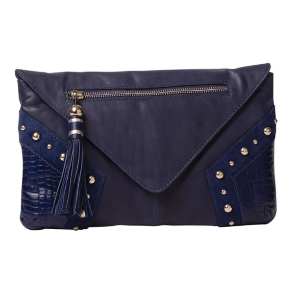 C-ROCK CHIC CLUTCH    A little bit of rock, a lot of chic!     This envelope C-rock Chic Clutch features stud and snake corner detail, as well as a top zip with leather tassel puller. Making sure there is room for everything there is a back zip and inside zipped pocket and phone compartments. Hand crafted from soft European calf, inside it features a designer leather plaque and is lined in signature twill.  Comes with Monique drawstring tote dust bag.    $169.00