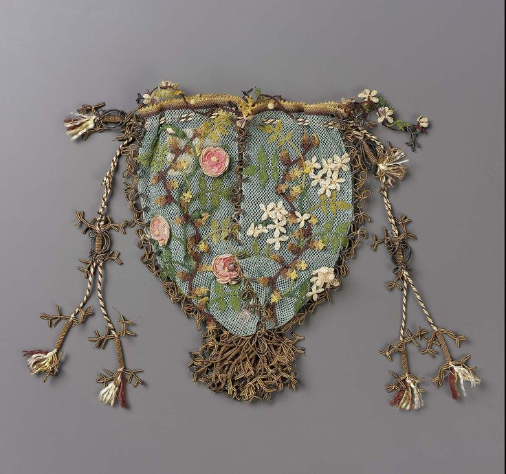 Lace bag made of silk net with silk bibila lace, gilt metal thread and tassels, and silk cording and was made in the 1800s. It's hard to believe that something this delicate has survived.