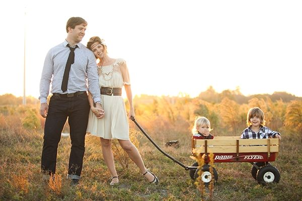 125+ Family and Sibling Photos to Get Posing Ideas and Inspiration cute wagon for little ones, one kid behind pretending to push, couple behind wagon holding hands and one towards handle... Then us!