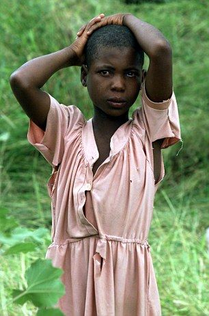 Too young for marriage: A young girl in Mozambique, where parents are sending their daughters to child sex camps to be taught how to please a man in bed (file photo)
