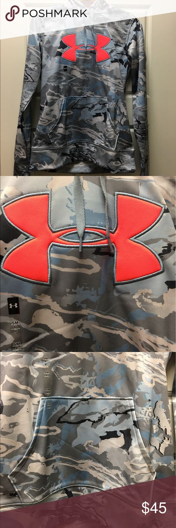 UNDER ARMOUR FLEECE CAMO BIG LOGO WOMEN'S HOODIE Loose: Generous, more relaxed fit. UA Storm 1: Water-Resistant Armour® Fleece construction delivers a brushed inner layer & a smooth, quick-dry outer layer Signature Moisture Transport System wicks sweat to keep you dry & light Lined adjustable hood with crossover neckline for easy on/off Front kangaroo pocket Allover camo print Polyester Under Armour Tops Sweatshirts & Hoodies