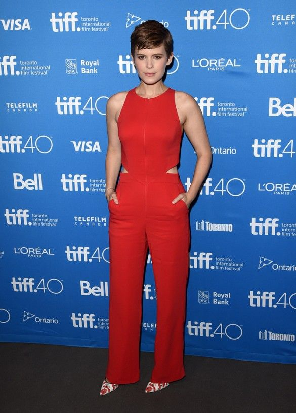 Kate Mara wears a red cutout jumpsuit with printed heels