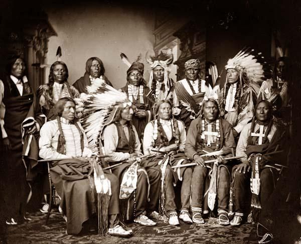 You are looking at an artistic picture of Red Cloud and Indians. Standing - Red Bear (Sons Are?), Young Man Afraid of his Horse, Good Voice, Ring Thunder, Iron Crow, White Tail, Young Spotted Tail. Seated - Yellow Bear, Jack Red Cloud, Big Road, Little Wound, Black Crow. It was created in 1865.    The picture presents Indians of North America.
