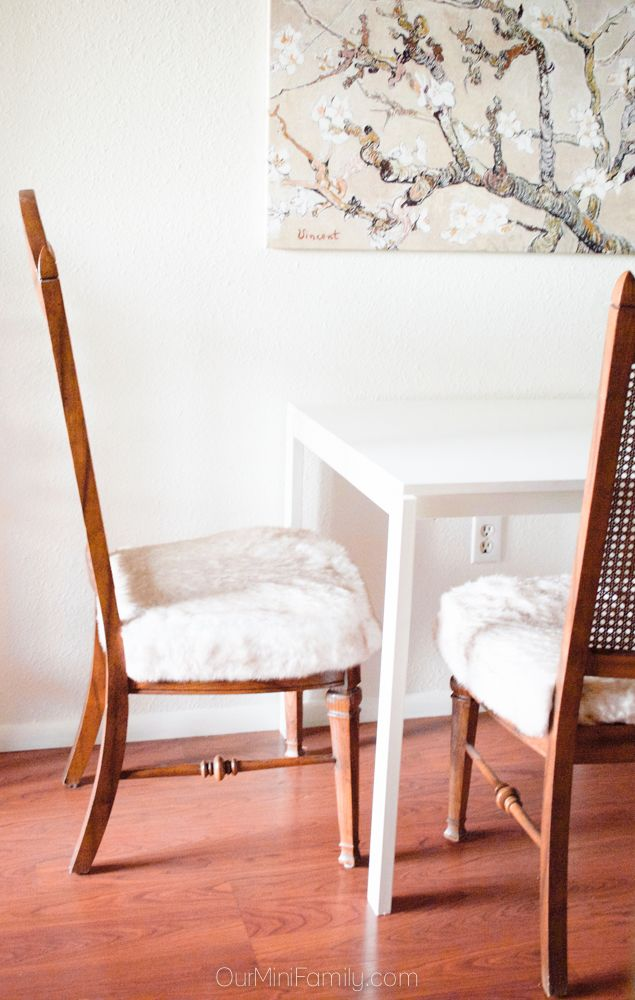 Sharing these thrift store dining room chairs I found and how I reupholstered them into our own style for our home into faux fur chairs!