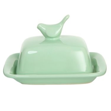 This pretty piece by Carolyn Donnelly Eclectic will complement a range of kitchen decors. The lid incorporates a bird-shaped handle while the dish is turned up at the corners.