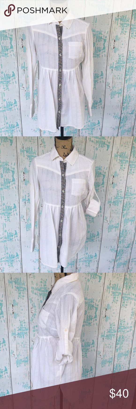 "Free People button down white tunic size 8 Free People button down white tunic size 8. The sleeves can be rolled up as well as shown.   🍥Bundle deals available (I carry various sizes and brands in my closet): 2 items 10% off, 3 items 15% off, 4 items or more 20% off.  🍥No trades, modeling, or lowball offers please. 🍥All reasonable offers accepted only through ""offer"" button. Please submit offer willing to pay as I prefer to not counteroffer. 🍥Happy Poshing! Free People Tops Tunics"