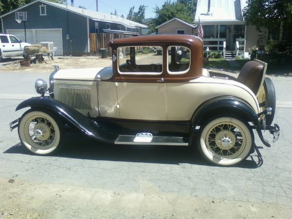 """1930 Model """"A"""" Ford Coupe.... Fun cars to drive... Don't go real fast but you do get there....usually :)"""