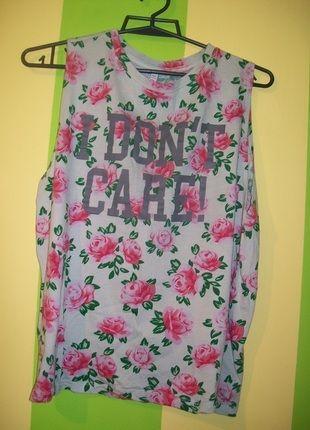 Kup mój przedmiot na #Vinted http://www.vinted.pl/damska-odziez/koszulki-na-ramiaczkach-koszulki-bez-rekawow/6405458-koszulka-kwiatowa-z-wycieciami