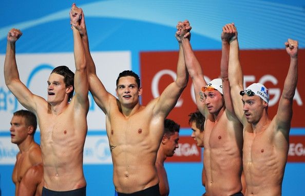(L-R) Yannick Agnel, Florent Manaudou Fabien Gilot and Jeremy Stravius of France celebrate after the Swimming Men's 4x100m Freestyle on day nine of the 15th FINA World Championships at Palau Sant Jordi on July 28, 2013 in Barcelona, Spain.