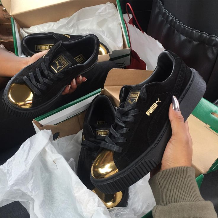 Black Rihanna Puma creepers with gold toe cap
