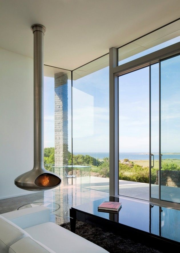 Fireplace with a view at Etoile du Nord, Guernsey by Jamie Falla Architecture