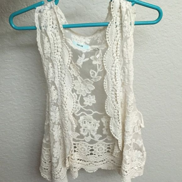 Lacey vest This is a cute cropped white lace vest. It dresses up any outfit! Kimchi Blue Jackets & Coats Vests