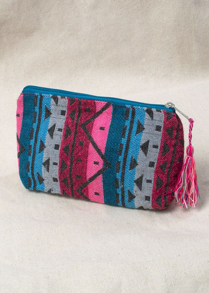 This pink, grey, black, and red aztec zip up pouch will quickly become one of…
