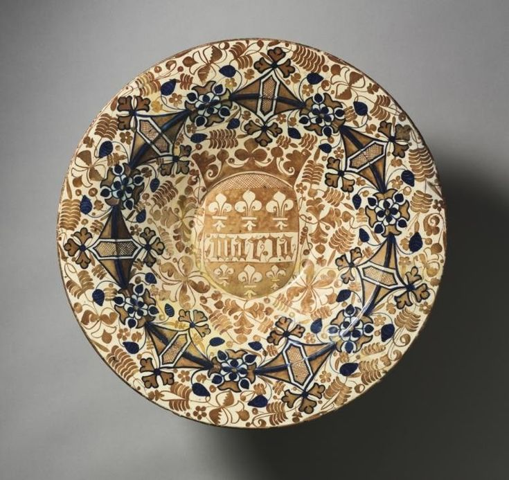 """Plate with the Name """"Maria"""" Plate with the Name """"Maria"""", c. 1437 Spain, Valencia, 15th century tin-glazed earthenware, gold lustre, Diameter - w:46.70 cm (w:18 3/8 inches) Overall - h:5.80 w:47.00 cm (h:2 1/4 w:18 1/2 inches). Purchase from the J. H. Wade Fund 1944.292"""