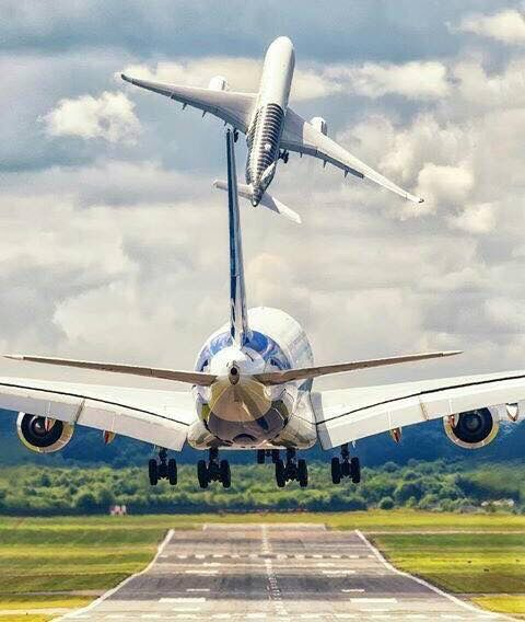 Air New Zealand Boeing B787 Dreamliner takes off • while another airplane lands •