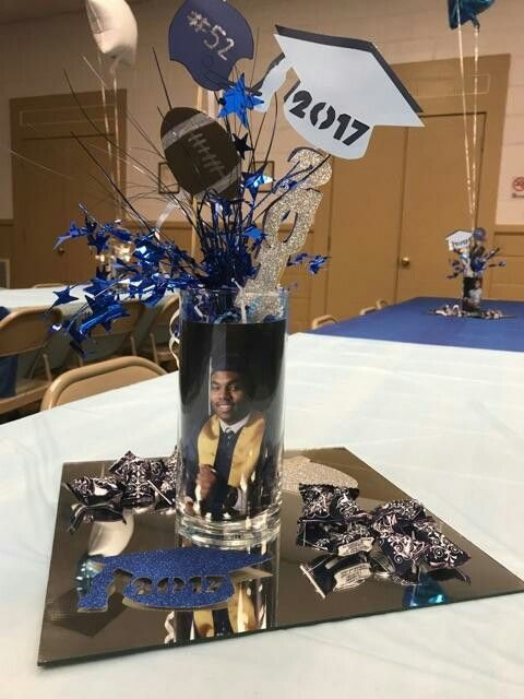 Graduation centerpiece with grad picture and cut outs.