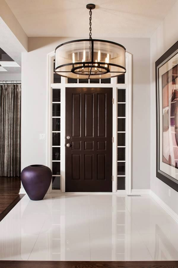 Are you looking for a way to add a wow-factor to your entryway? Use one or all of these nine elements to create an impressive room for your guests. #interiorremodel #interiorrenovation #homeremodel #homerenovation #foyer #entryway #foyerremodel #contractor #design #renovation #remodel #homeimprovement #interiordesign #style #homedecor #HCRemodel