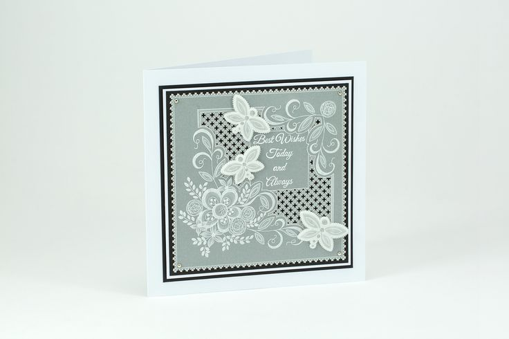 Going back to basics, this is a simple white work card using various embossing and grid work techniques