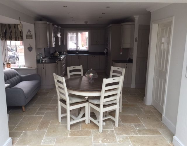 This kitchen diner looks great laid with our Light Tumbled Travertine in the opus pattern.