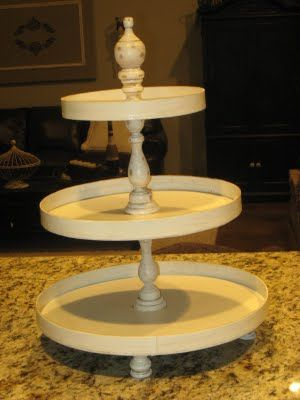 Three hat boxes (hobby lobby), 2 candle sticks, 4 little wooden candle sticks for legs and a wooden finial..spray paint, sand and glaze for an antique look! Great idea! (you can use the bottom of hat boxes for storage or cut wall art!)