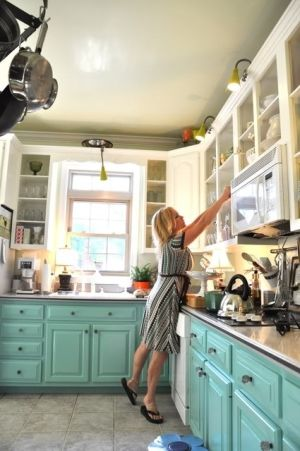 Kitchen makeover for less than $500! Lower cabinets painted turquoise WITHOUT sanding, upper doors removed.  Sources all listed.  via lifeingrace