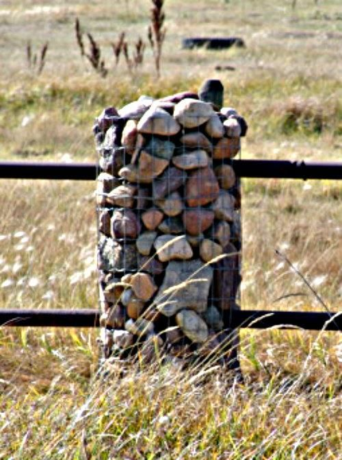 a close look at the pipe construction and loose stones held by wire.