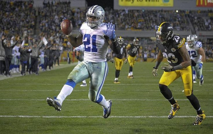Cowboys vs. Steelers  - 35-30, Cowboys  -  November 13, 2016:    Dallas Cowboys running back Ezekiel Elliott (21) scores a fourth quarter touchdown in front of Pittsburgh Steelers free safety Mike Mitchell (23). Max Faulkner mfaulkner@star-telegram.com