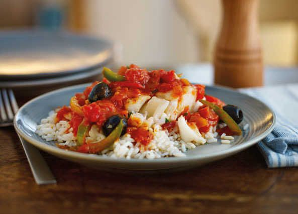 Mediterranean Cod Recipe Main Dishes with olive oil, chopped onion, chopped garlic, chopped tomatoes, tomato purée, pepper, boneless cod fillets, pitted black olives, chopped parsley, white rice