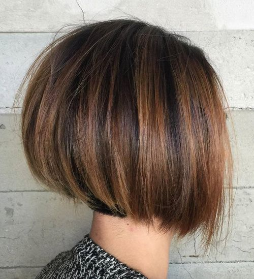 Rounded Brown Balayage Bob layers underneath very swinging/lots of motion hair