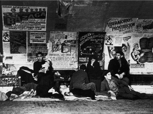 Robert Capa     Civilians Sheltering from Italian and German Bombing in a Subway Station, Madrid     1936