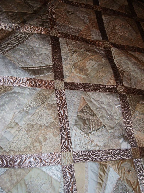 reuse - wedding dress made quilt - this would be wonderful for in your bedroom. or in a wedding ring pattern.