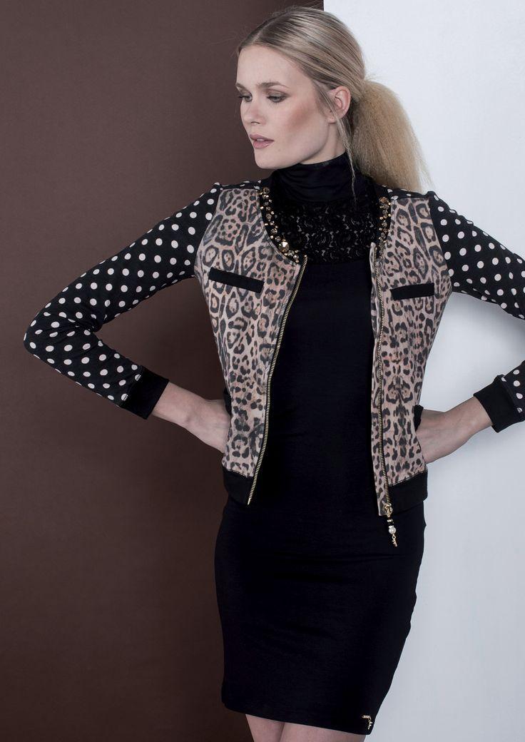 Brilla di stile con il nostro dress total black abbinato al cardigan con fantasie intrecciate. #fracomina #fallwinter