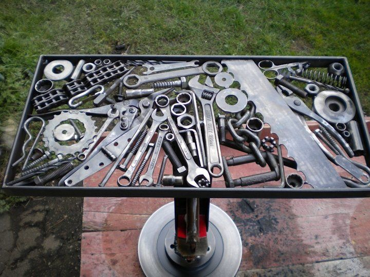 Not a glass table, but welded tools. Someone took time and care with this table. (Vehicular Furnishings and Automotive Decor)