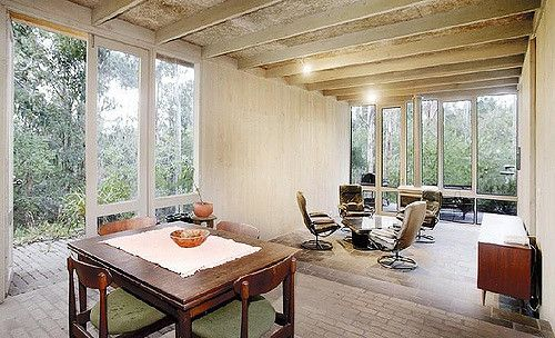 """Architect: Robin Boyd  McClune Residence  """"The McClune House, 1969, near Frankston… has a big parasol roof of steel and fibreglass sheeting in the shape of a square doughnut, supported on steel-braced timber posts independent of the structure of the rooms. These follow a comparatively free plan beneath a raised roof, avoiding the central open square where a garden court receives the rain. The rooms are conventionally framed as flat-roofed boxes lined externally and internally with off-sa..."""