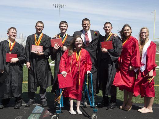 USA TODAY - McCaughey septuplets graduate high school -  PHOTO: The McCaughey septuplets pose with their principal