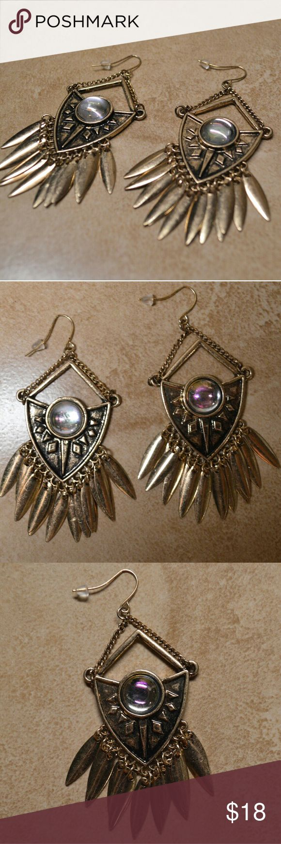 Stunning Brand New Gold Native Feather Earrings These beauties are a great find! Shiny gold earrings with dangly feathers at the bottom of each. Remind me of a native American design or dreamcatcher. Abalone shell stone (synthetic?) accents. Truly gorgeous!  These are brand new and perfect! They do have a weathered/distressed finish.     Tags feathers feather boho bohemian hippy earrings dangle dangly native American Indian web gold classy girly hook earrings topshop Navajo Aztec Jewelry…